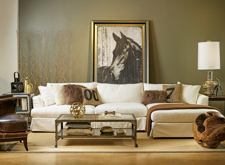 Dark green wall colour, with artistic print of a horse on it and white sofa