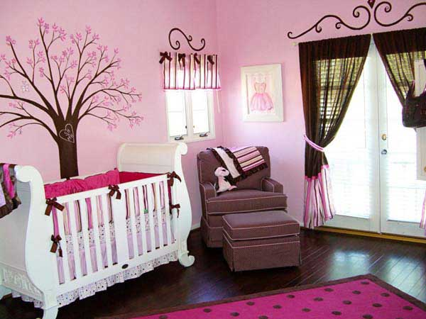 Classic baby bedroom design with decorative tree painting on the wall