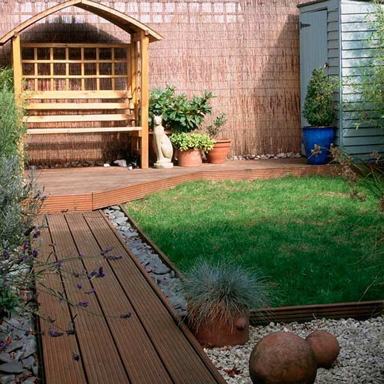 Small Garden With Decked Path And Arbour: Small Garden Pathway Ideas Photograph