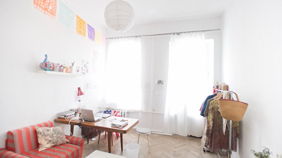 11 large room Apartment of Graphic and Fashion Designers Redecorated on the Rims with Loads of Wheeled Restored Furniture