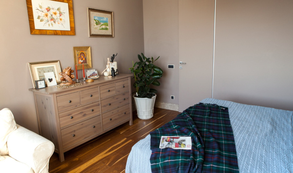 111-bedroom features IKEA chest of drawers and an arm-chair