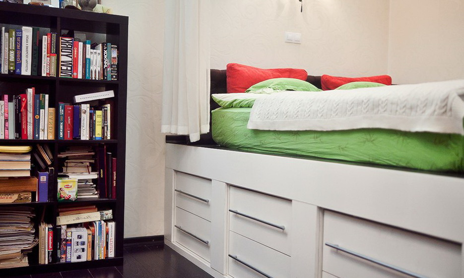 studio apartment with a raised platform bed and wide