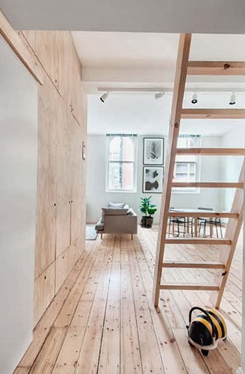 The Living Room Is Very Wide Floor Laid In A Similar Color And Plywood Also Wall Lined With Second Level Holds Beautiful