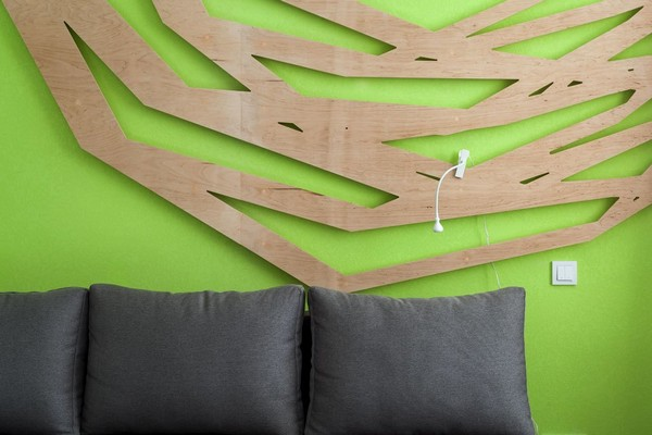 0-modern-ascetic-interior-3D-geometrical-wooden-wall-panel-decor-black-sofa-bright-green-wall