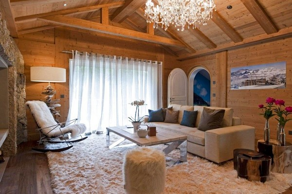 1-51-Degrees-Thermal-Resort-spa-mansion-in-swiss-alps-chalet-interior-design-crystal-chandelier-white-sofa-rocking-chair