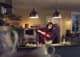 1-light-in-interior-warm-woman-cooking-in-the-kitchen
