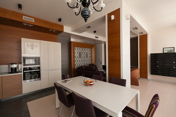 1-minimalist-style-open-concept-living-room-kitchen-purple-sofa-and-chairs-load-bearing-columns-white-dining-table-frosted-glass-sliding-doors