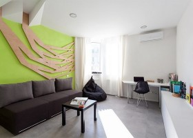 1-modern-ascetic-interior--living-room-with-white-walls-black-sofa-black-frameless-arm-chair-work-area-zone-white-glossy-cabinets-3D-geometrical-wooden-wall-panel-decor-bright-green-wall