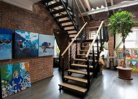 11-creative-interior-design-artist's-apartment-studio-artworks-paintings-political-sports-theme-brick-wall-staircase