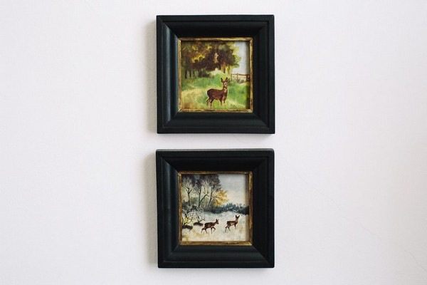11-scandinavian-eclectic-interior-design-IKEA-furniture-small-paintings-deer-nature