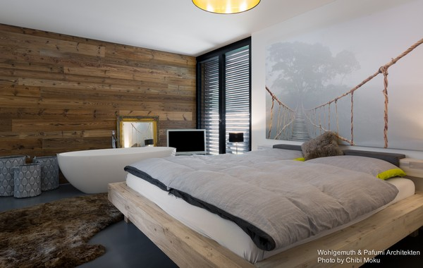 11-swiss-minimalist-modern-bedroom-wooden-wall-photo-digital-wall-printing-bathtub-in-the-bedroom