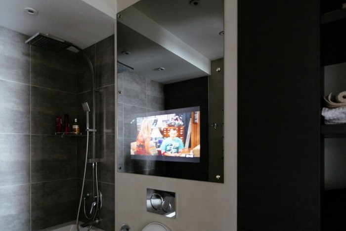 12-brutal-loft-style-bathroom-gray-walls-mirror-concealed-tv-set