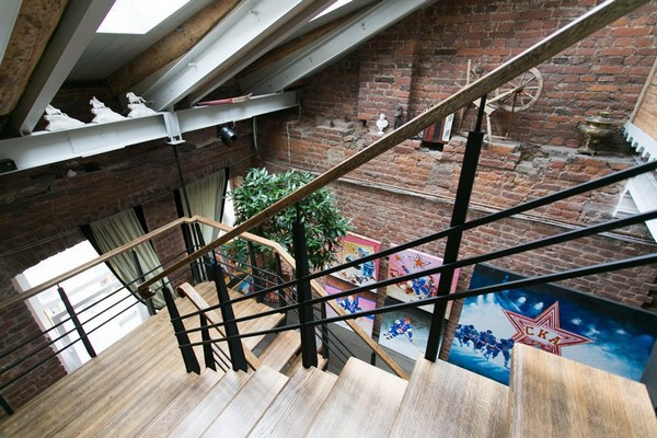 13-creative-interior-design-artist's-apartment-studio-artworks-paintings-political-sports-theme-brick-wall-staircase