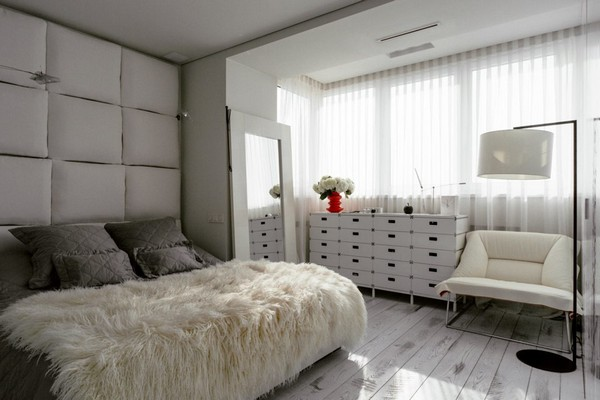 14-white-bedroom-molteni-chest-of-drawers-ingo-maurer-standard-lamp-pillows-headboard-moroso-arm-chair