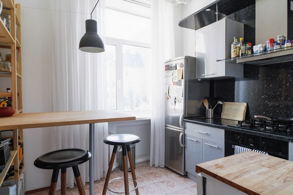 16-scandinavian-eclectic-interior-design-IKEA-furniture-kitchen-bar-stools-black-splashback-shelving-unit