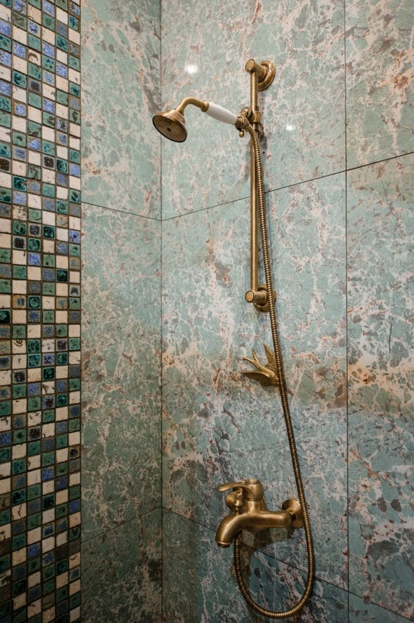 16-vintage-style-beige-and-turquoise-sauna-interior-retro-brass-shower-head-mosaic-aged-tiles