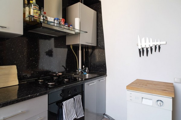 17-scandinavian-eclectic-interior-design-IKEA-furniture-kitchen-black-splashback-white-walls