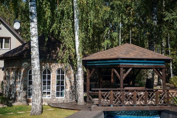 2-outdoor-territory-swimming-pool-chocolate-brown-and-turquoise-garden-gazebo-design-bridge-tall-birch-trees