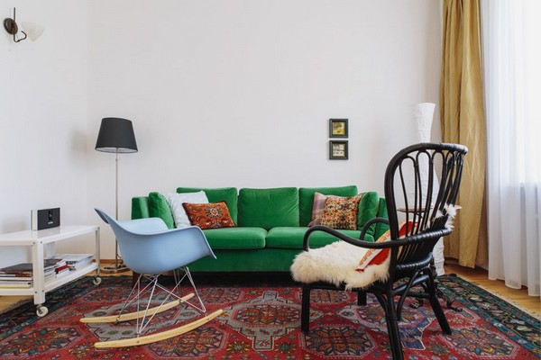 2-scandinavian-eclectic-interior-design-IKEA-furniture-green-velvet-sofa-old-piano-vintage-rug-beige-curtains-blue-rocking-chair-wheeled-white-table-living-room