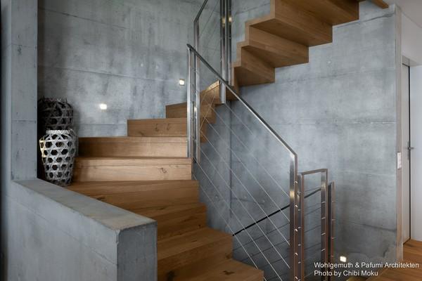 2-swiss-minimalist-modern-wooden-staircase-concrete-walls-floor-bowls