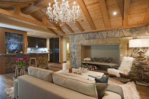 3-51-Degrees-Thermal-Resort-spa-mansion-in-swiss-alps-chalet-interior-design-fireplace-rocking-chair-living-room-crystal-chandelier