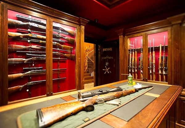 3-gun-room-hunters-room-interior-design-leather-coated-hunter's-table-gun-storage-cabinets