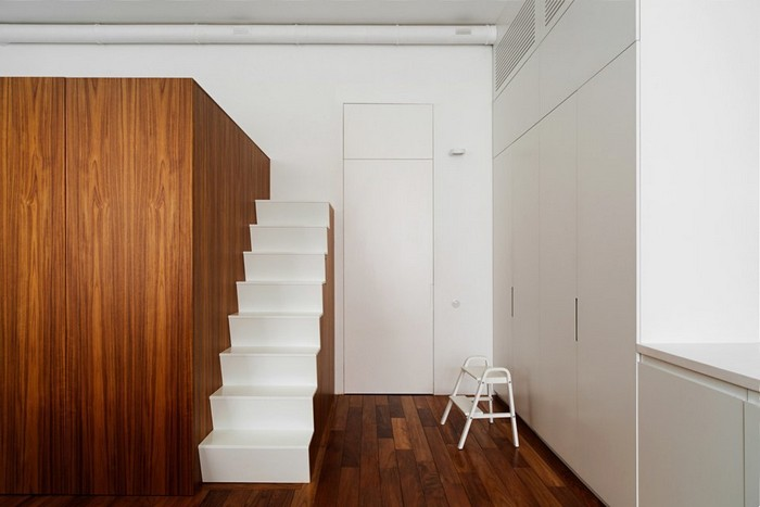 3-modern-minimalist-studio-apartment-loft-bed-stairs-white-walls