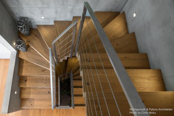 3-swiss-minimalist-modern-wooden-staircase-concrete-walls-floor-bowls