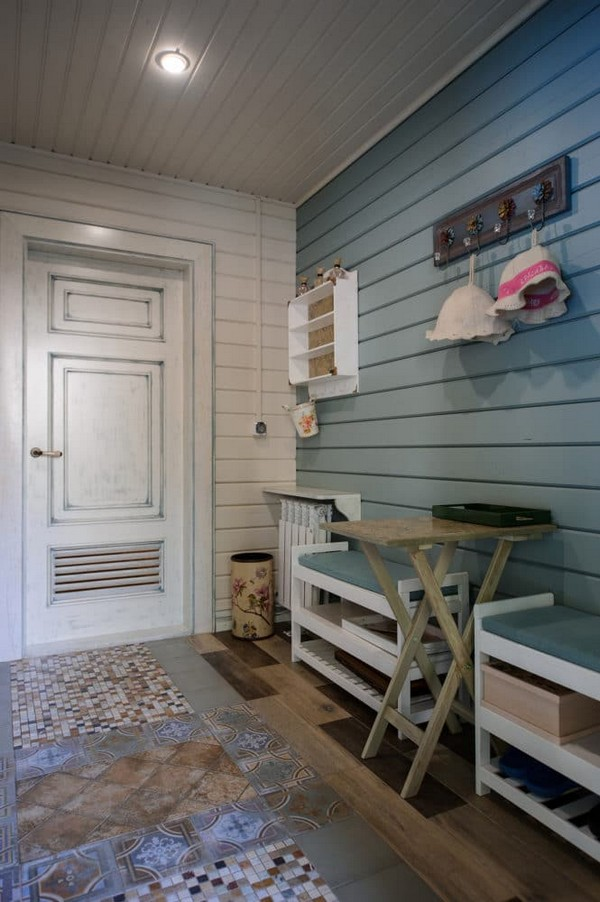 3-vintage-style-beige-and-turquoise-sauna-interior-entry-room-bird-theme-decor-pattern-aged-door-with-vent-grilles-decoupaged-furniture-mixed-tiles-mosaics-ceramic-flooring-wooden-walls