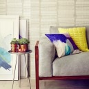 4-decorative-couch-pillows-in-living-room-interior-design-abstract-pattern