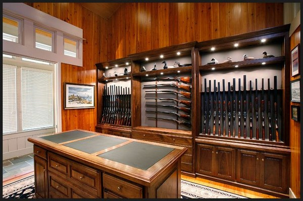 4-gun-room-hunters-room-interior-design-leather-coated-hunter's-table-gun-storage-cabinets