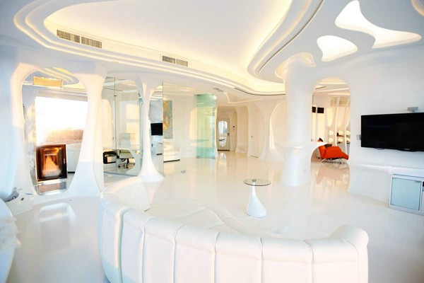 4--total-white-glossy-futuristic-style-interior-design-panoramic-windows-self-levelling-floor-de-sede-sofa-columns-3D-ceiling-living-room