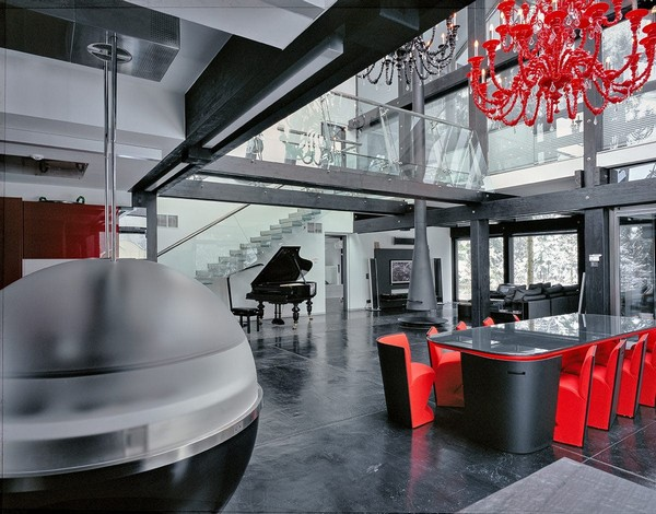 4-unusual-glass-house-panoramic-windows-open-plan-concept-kitchen-living-room-unusual-round-ball-shaped-kitchen-island-red-dining-table-chandelier-console-staircase-fireplace-piano