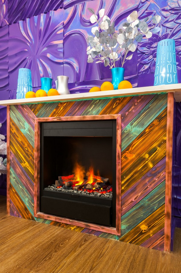 5-bright-positive-interior-purple-orange-white-living-room-3D-gypsum-wall-wooden-fake-fireplace-multicolor-charred-wood