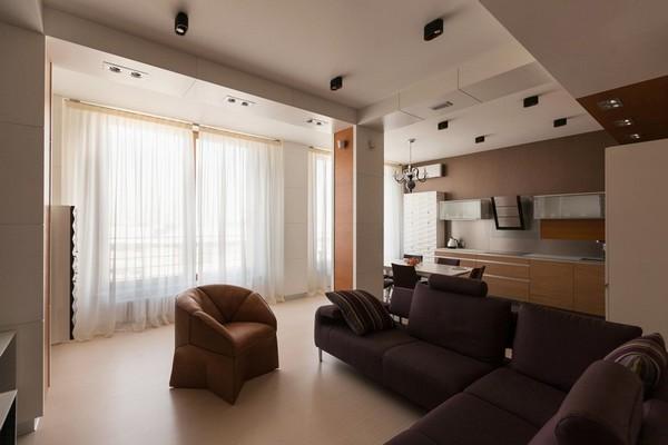 7-minimalist-style-open-concept-living-room-kitchen-purple-sofa-beige-arm-chair-load-bearing-columns