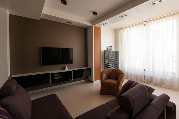 8-minimalist-style-open-concept-living-room-kitchen-purple-sofa-beige-arm-chair-load-bearing-columns-black-3d-chest-of-drawers