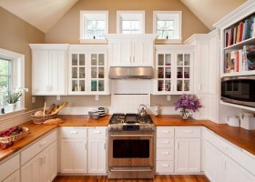 8-white-kitchen-glass-cabinets-oak-tabletop-floor
