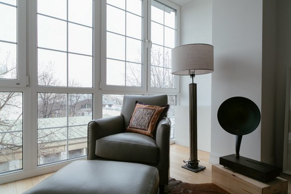 9-minimalist-interior-style-white-walls-my-america-gray-arm-chair-by-panoramic-window-white-big-standard-floor-lamp