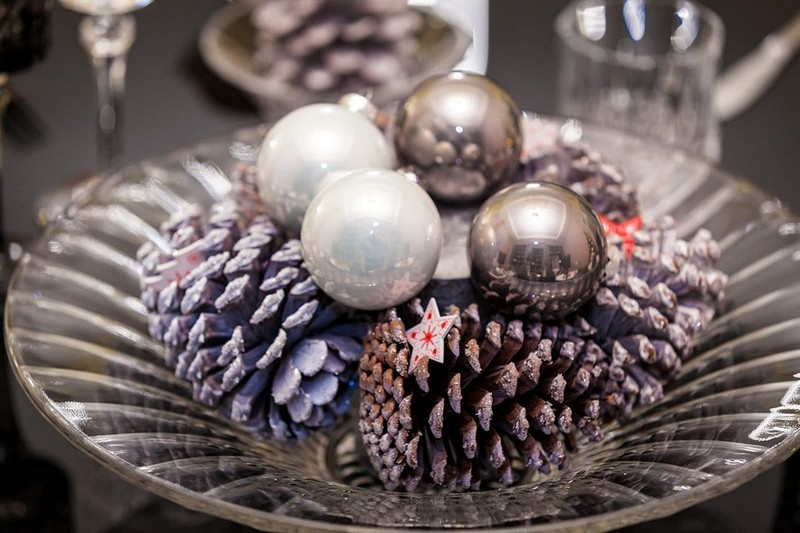 0-beautiful-Christmas-New-Year-composition-silver-painted-cones-balls-glass-plate-festive-table-setting-composition
