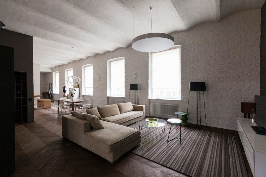 0-minimalist-style-interior-design-apartment-open-concept-plan-living-room-dining-kitchen-old-white-brick-wall-beige-corner-sofa-stripy-carpet-arched-ceiling-many-four-windows