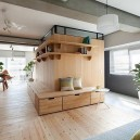 0-totally-wooden-apartment-with-unusual-L-shaped-layout-open-concept-wooden-floor-walls-furniture-kitchen-living-room-concrete-ceiling-without-doors