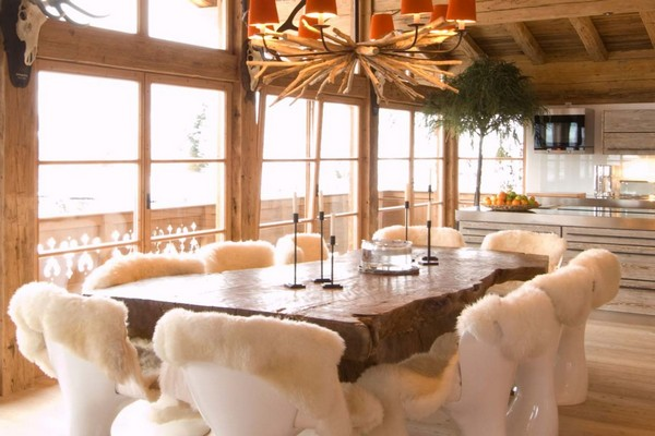 1-chalet-style-wooden-house-open-concept-living-room-massive-dining-table-chairs-sheep-skins-fur-wooden-designer-ceiling-lamp-chandelier-fireplace-beams-panoramic-windows
