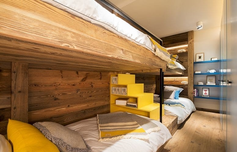 10-chalet-style-interior-design-stone-wood-toddler-room-kid's-bedroom-wooden-loft-bed-yellow-and-turquoise-blue-accents-stairs-shelves