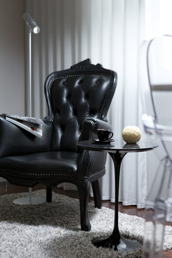 10-cozy-elegant-neo-classical-modern-black-and-white-interior-design-open-concept-living-room-black-leather-arm-chair-Mui-Olivar-coffee-table
