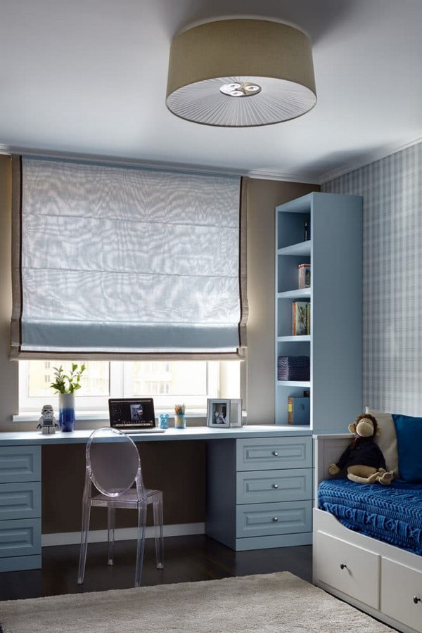 10-light-blue-and-grain-restrained-neutral-toddler-room-design-Kartell-transparent-chair-Roman-blinds-IKEA-bed-with-drawers-o-design-wallpaper-blue-knitted-bedspread