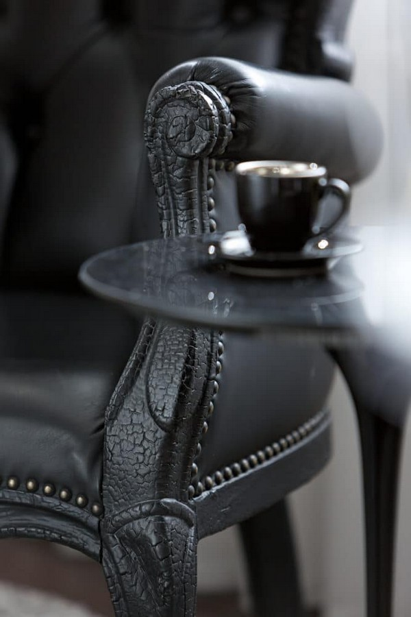 11-cozy-elegant-neo-classical-modern-black-and-white-interior-design-open-concept-living-room-black-leather-arm-chair-Mui-Olivar-coffee-table