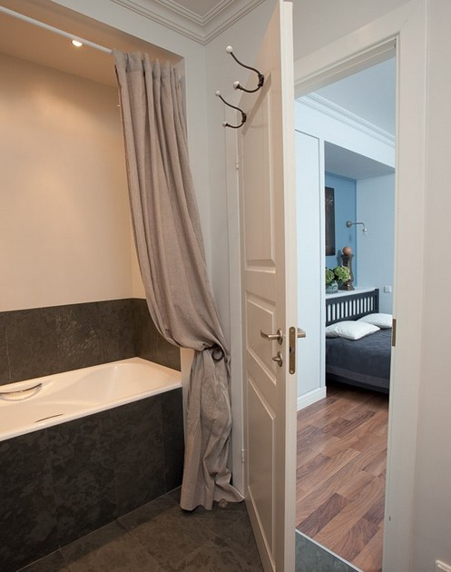 11-draped-beige-shower-curtain-forged-tie-back-bathtub-in-alcove-bedroom-exit