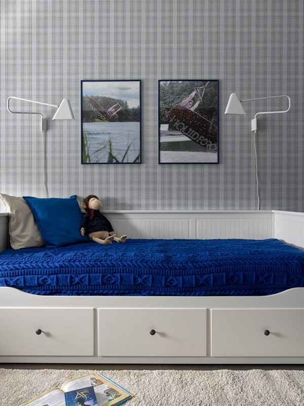 11-light-blue-and-grain-restrained-neutral-toddler-room-design-IKEA-bed-with-drawers-wall-lamps-o-design-wallpaper-blue-knitted-bedspread
