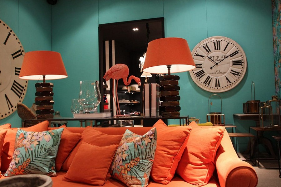 12-Fancy-furniture-at-Maison-and-&-Objet-2017-Exhibition-trade-fair-Paris-bright-ochre-orange-sofa-desk-lamps-big-clock-flamingo-figurine-in-interior-design