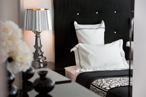 13-cozy-elegant-neo-classical-modern-black-and-white-interior-design-bedroom-textile-headboard-Mui-Philippe-Starck-silver-bedside-lamp
